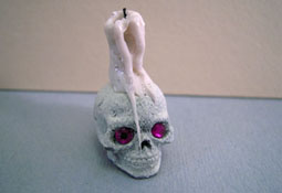 "Crickets And Caterpillars 1"" Scale Creepy Skull Candle"
