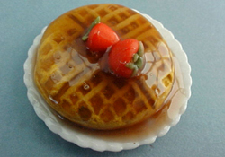 "1"" Scale Waffle With Strawberries And Syrup"