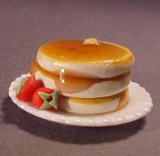 "1"" Scale Pancakes With Strawberries And Syrup"