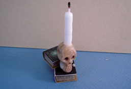 "Taylor Jade 1"" Scale Creepy Skull Candle On Books"