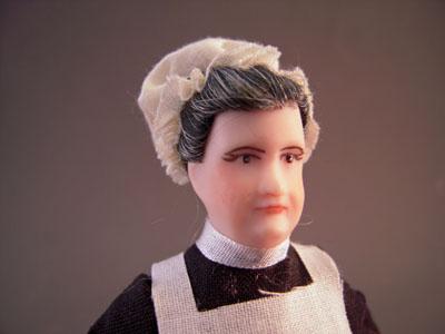 """ci211 1"""" scale porcelain nanny or housekeeper doll"""