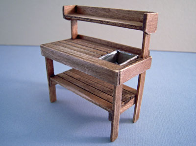 "1/2"" scale antique walnut potting bench"