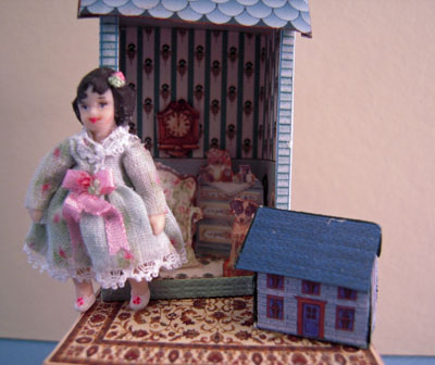 "1"" scale loretta kasza hand crafted dollhouse on a table blue"