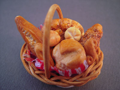 """mcm807 1"""" scale mcm bread in a woven basket"""